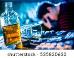 Small photo of Depressed young woman tries to commit suicide by medicine and alcohol overdose