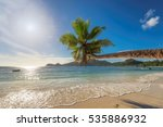 coconut palm on tropical beach... | Shutterstock . vector #535886932