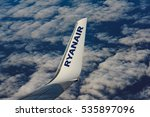 BARCELONA, SPAIN - DECEMBER 23, 2015: Low-cost airline RYANAIR logo on airplane's wing - stock photo