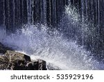 Cascading Water Smashes Over...