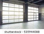 Empty interior auto-motor speedway garage door - stock photo