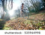 mature man riding bike in the... | Shutterstock . vector #535964998