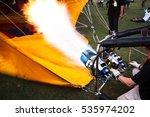 inflating a hot air balloon... | Shutterstock . vector #535974202