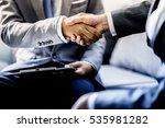 businessman shaking hands to... | Shutterstock . vector #535981282