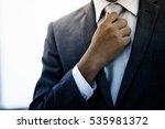 businessman adjust necktie his... | Shutterstock . vector #535981372
