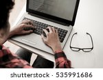programmer typing new lines of... | Shutterstock . vector #535991686