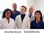 Small photo of Portrait Of Medical Staff In Hospital Exam Room