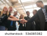 Group Of Business People Join...