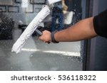 cleaning windows with a squeegee | Shutterstock . vector #536118322