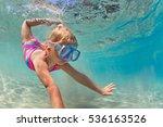 happy baby girl in snorkeling... | Shutterstock . vector #536163526