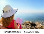 curly hair woman reading a book ... | Shutterstock . vector #536206402