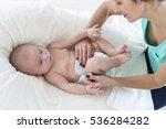 mom puts on diaper baby ... | Shutterstock . vector #536284282