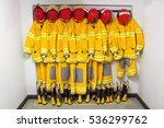 Small photo of Firefighters in yellow fire-proof uniform