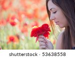 young beautiful girl holding a...