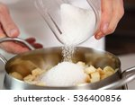 pouring sugar into saucepan...