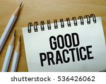 Small photo of Good Practice text written on a notebook with pencils