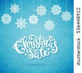 christmas sale poster with hand ... | Shutterstock . vector #536448922