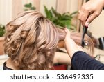 wrap hair curling in a beauty... | Shutterstock . vector #536492335