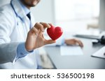 male doctor holding red heart... | Shutterstock . vector #536500198