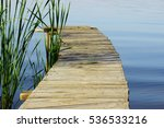 A Wooden Pier For Small River...