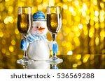 snowman between glasses of... | Shutterstock . vector #536569288