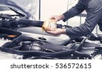 mechanic pouring oil into car... | Shutterstock . vector #536572615