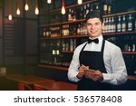 handsome male waiter in cafe | Shutterstock . vector #536578408