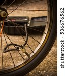 Small photo of Inflating bicycle tire with air power pump