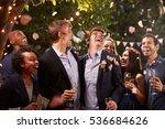 Gay Couple Celebrating Wedding...