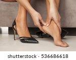 woman massaging her tired feet | Shutterstock . vector #536686618