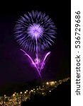 Purple Fireworks Light Up The...