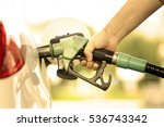 hand refilling the car with... | Shutterstock . vector #536743342