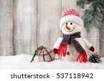 Snowman And Christmas Ball On...