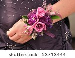 Purple and Pink Flowers (Roses) on Wrist Corsage for Prom - stock photo