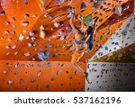 Young Woman Bouldering In...