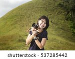 young woman taking photo on the ...   Shutterstock . vector #537285442