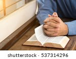 a man reading the holy bible. | Shutterstock . vector #537314296
