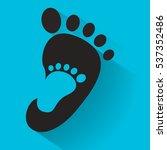 baby footprint in adult foot... | Shutterstock .eps vector #537352486
