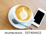 cup of coffee and mobile...   Shutterstock . vector #537404422