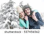 happy couple posing in winter... | Shutterstock . vector #537456562