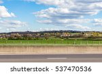 Small photo of Village of Abridge in Essex taken from the other side of the M11 with a beautiful cloudy and blue sky.