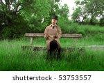 Gentleman Sitting On A Park...