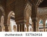Small photo of GRANADA, SPAIN - November 25, 2016: Interior of Alhambra. Columns with muqarnas ceiling decoration and arabesques.