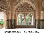 Small photo of GRANADA, SPAIN - November 25, 2016: Interior of Alhambra. Muqarnas ceiling decoration and arabesques.