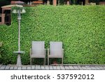 Two Chairs With The Green Plan...