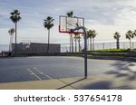 An Empty Basketball Court By...