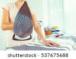 closeup of woman ironing... | Shutterstock . vector #537675688