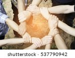 many hands together holding... | Shutterstock . vector #537790942