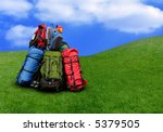 Pile of backpacks in the nature Environmental tourism concept - stock photo