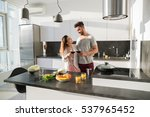 young couple embrace in kitchen ... | Shutterstock . vector #537965452